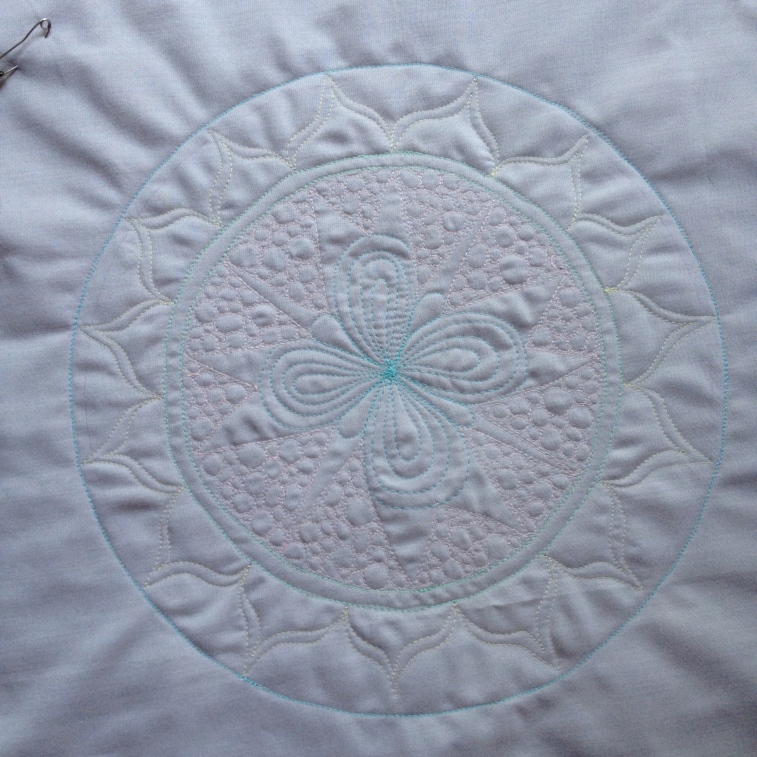 An Aurifil Mandala Wholecloth Mini Quilt