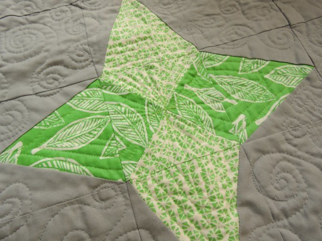 Aurora BOM triangle in a square quilting