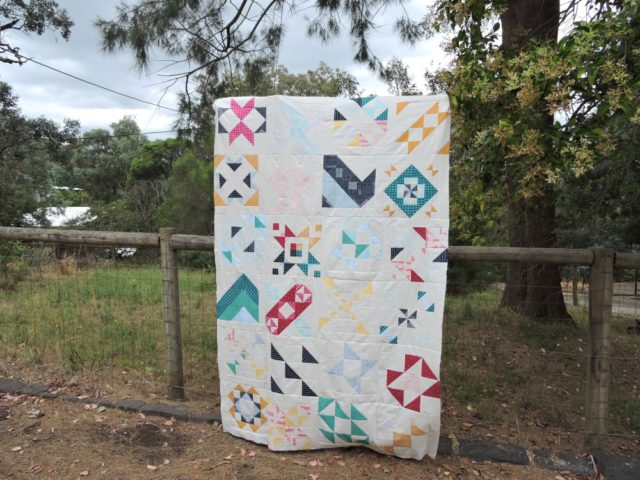 Modern HST Sampler quilt top in alternate gridwork by BlossomHeartQuilts.com