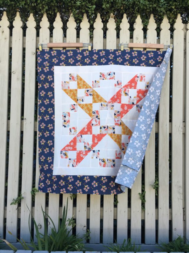 Sweet baby quilt using a Jacobs Ladder quilt pattern in Paper Meadow by JillyP Studio for Dashwood Studio