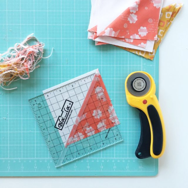 Tips for making half square triangles using a BlocLoc ruler for a Jacobs Ladder baby quilt on BlossomHeartQuilts.com