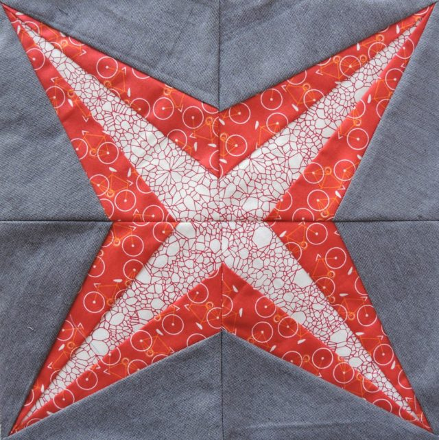 Alpha Centauri quilt block from the Milky Way Sampler at BlossomHeartQuilts.com
