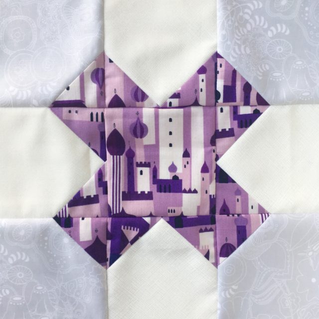 Purple Lizzy House Tic Tac Toe quilt block for a quilting bee using the pattern at BlossomHeartQuilts.com