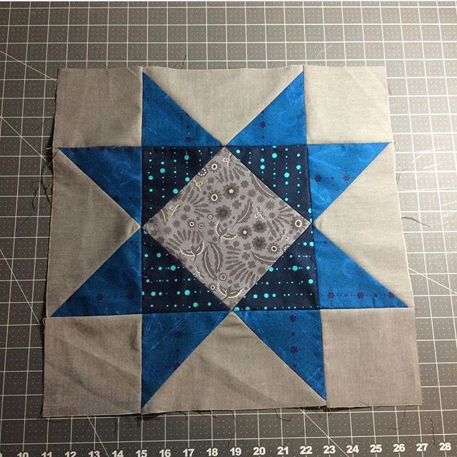 A beautiful blue star quilt block made from the Aurora BOM by BlossomHeartQuilts.com