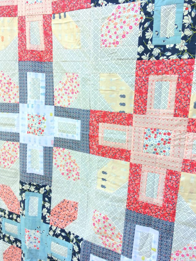 Showing off Charleston fabric by Amy Sinibaldi using the Symphony quilt pattern from Fat Quarter Shop. Made by BlossomHeartQuilts.com