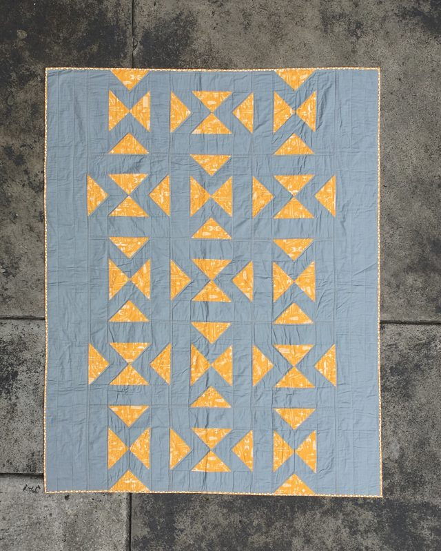 Directional quilt pattern by BlossomHeartQuilts.com using flying geese