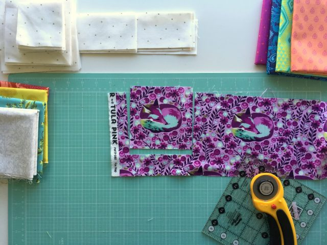 Fussy cutting fabric the Geode quilt by BlossomHeartQuilts.com