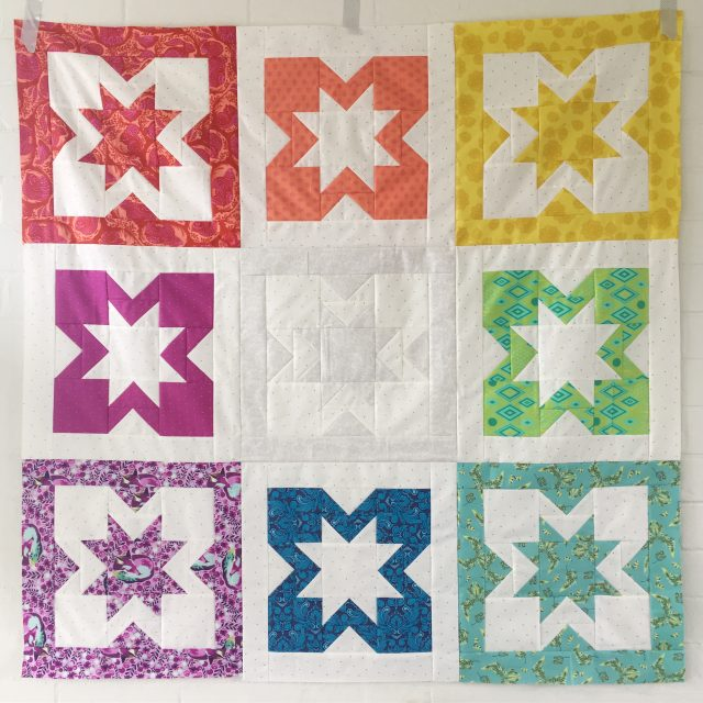 Tula Pink rainbow Geode quilt by BlossomHeartQuilts.com