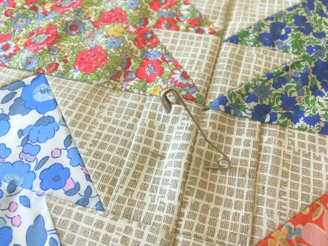 Pin basting a quilt
