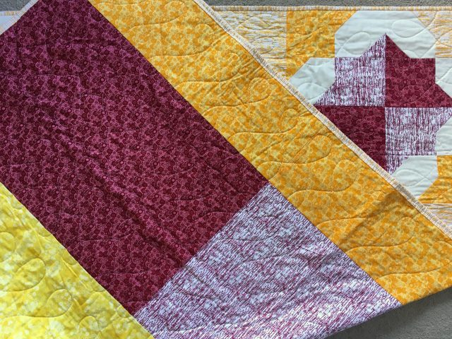 Scrappy quilt backings by BlossomHeartQuilts.com