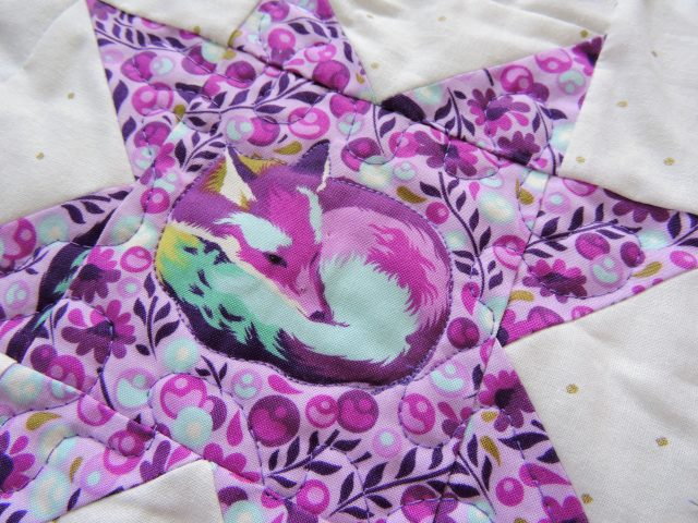 Free motion quilting on Tula Pink Geode quilt by BlossomHeartQuilts.com