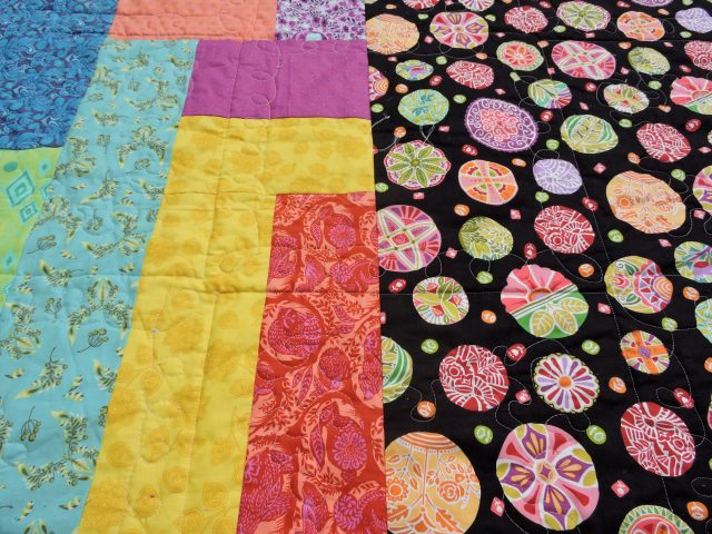 Free motion quilting on scrappy backing