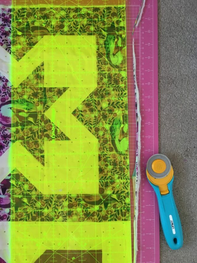 Trim a quilt top to bind
