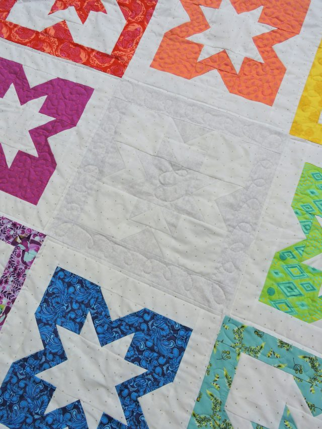 Use monogram free motion quilting on baby quilts by BlossomHeartQuilts.com