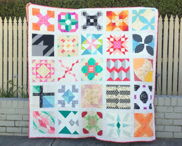 A 12'' block sampler quilt by Blossom Heart Quilts