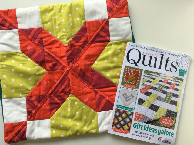 A quilted Christmas present cushion
