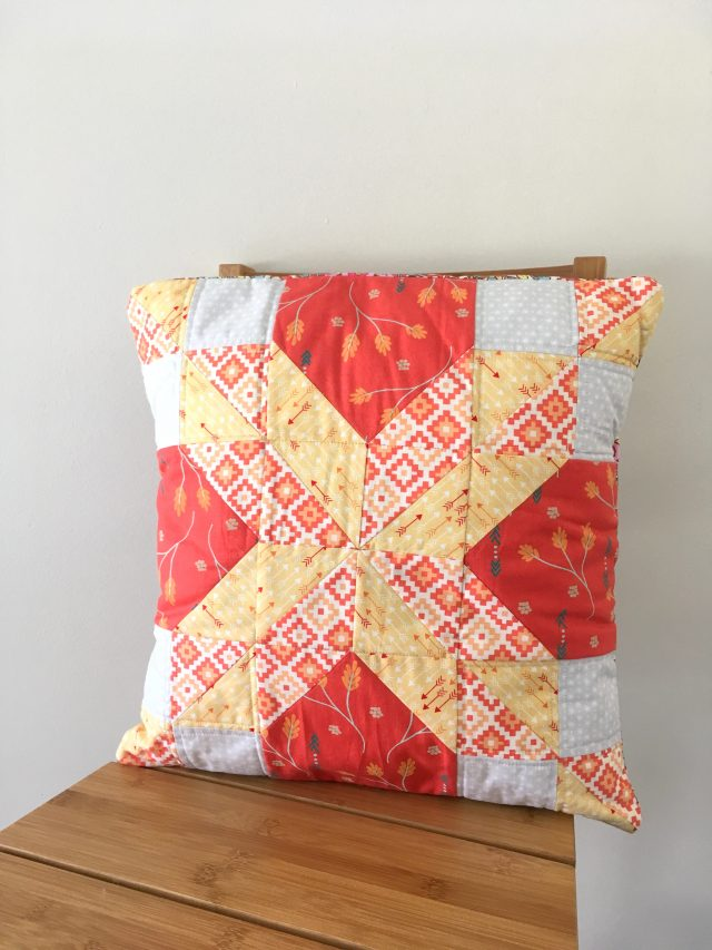 A quilted bithday present cushion