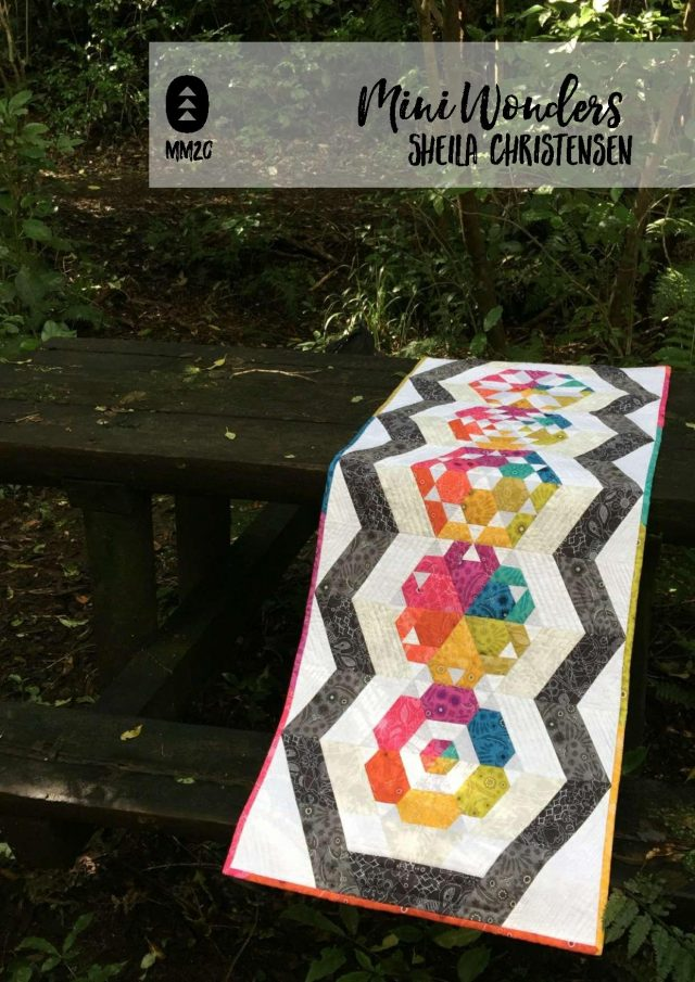 Alison Glass rainbow table runner with hexagons and triangles