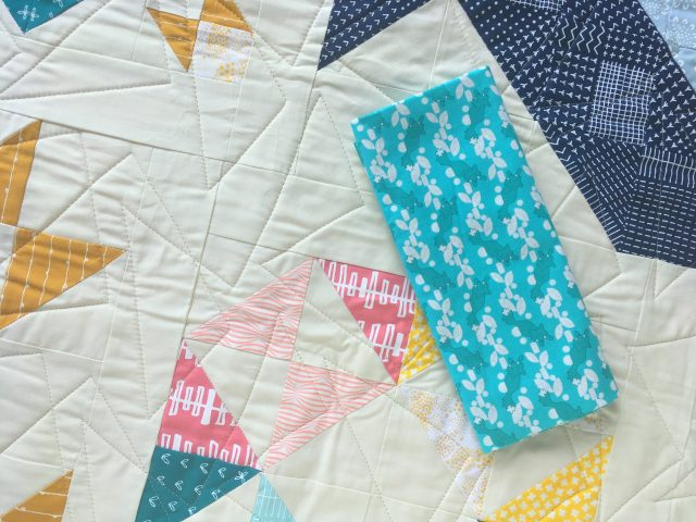 Teal binding for Modern HST Sampler quilt by Blossom Heart Quilts