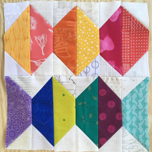 Abacus scrappy quilt block in warm and cool brights using the tutorial by BlossomHeartQuilts.com
