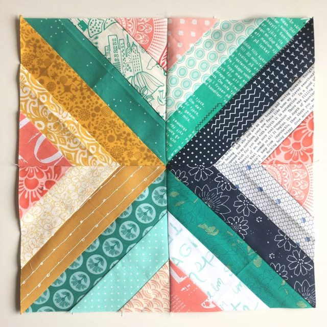 Treasure Hunt quilt block in navy, mustard, teal and coral by BlossomHeartQuilts.com